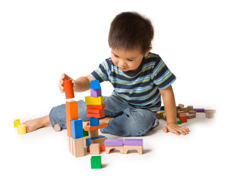 boy builds tower